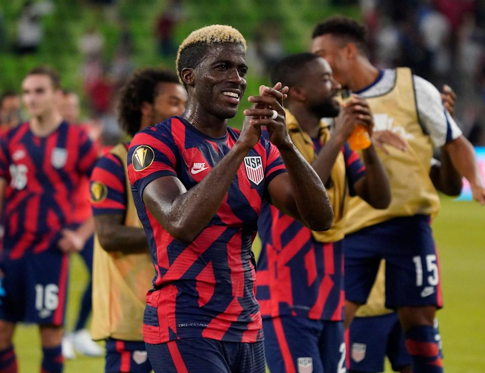 Gyasi Zardes acknowledges fans after the USMNT's victory over Qatar in a Concacaf Gold Cup semifinal at Q2 Stadium.