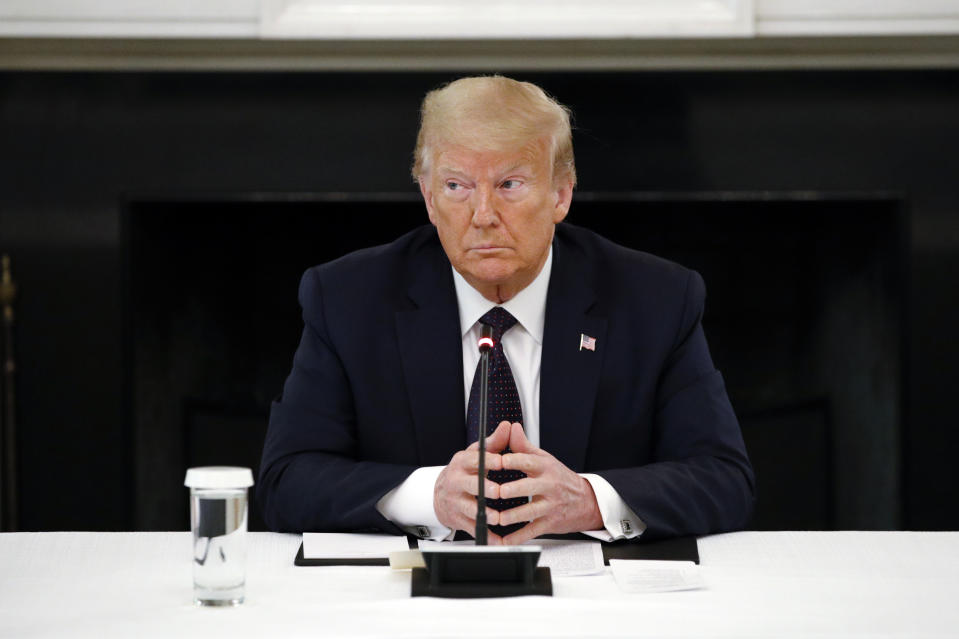 President Donald Trump listens during a roundtable discussion with law enforcement officials, Monday, June 8, 2020, in the State Dining Room of the White House in Washington. (AP Photo/Patrick Semansky)