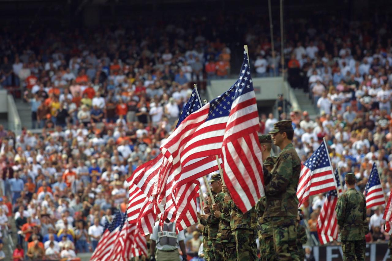 Soldiers line up with american flags during pre-game ceremonies before the game between the Detroit Lions and at Cleveland Browns at the Browns Stadium in Cleveland, Ohio. The Browns won 24-14. DIGITAL IMAGE. Mandatory Credit: Tom Pidgeon/Allsport