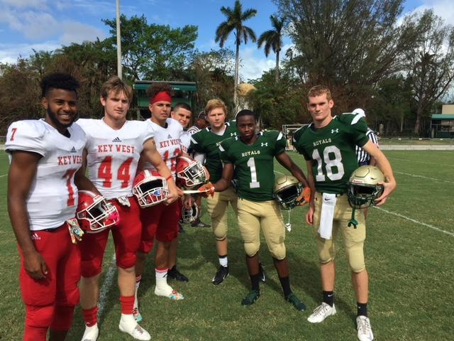 LaSalle High School players present a $3,000 donation to the Key West football team. (Courtesy of Key West High School)