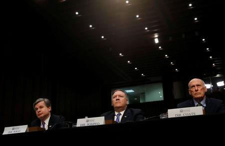"FILE PHOTO: Federal Bureau of Investigation (FBI) Director Christopher Wray; Central Intelligence Agency (CIA) Director Mike Pompeo; and Director of National Intelligence (DNI) Dan Coats testify before a Senate Intelligence Committee hearing on ""World Wide Threats"" on Capitol Hill in Washington, U.S., February 13, 2018. REUTERS/Leah Millis"