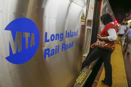 People board a Long Island Rail Road train at Pennsylvania Station in New York