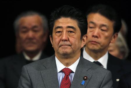 Japan's Prime Minister Shinzo Abe (C) attends a Northern Territories Day rally in Tokyo February 7, 2014. REUTERS/Yuya Shino