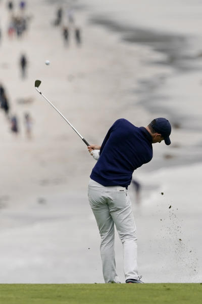 Rory McIlroy, of Northern Ireland, hits from the fairway on the ninth hole during the third round of the U.S. Open golf tournament Saturday, June 15, 2019, in Pebble Beach, Calif. (AP Photo/David J. Phillip)