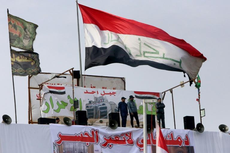 Iraqis at Tahrir square in the capital Baghdad amid ongoing anti-government protests (AFP Photo/SABAH ARAR)