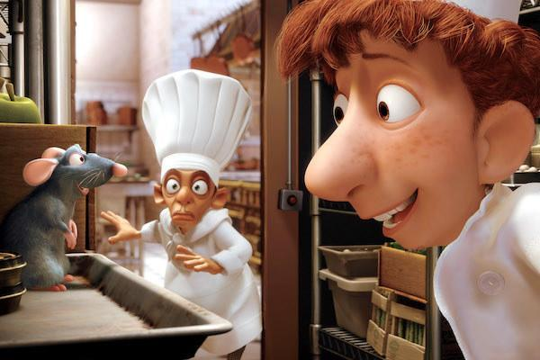 Remy (voiced by Patton Oswalt) and Skinner (voiced by Ian Holm) chat while Linguini (voiced by Lou Romano) looks shocked.