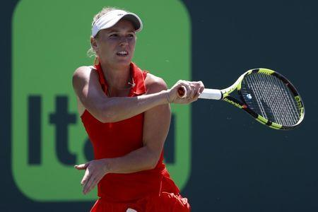 Mar 27, 2017; Miami, FL, USA; Caroline Wozniacki of Denmark hits a forehand against Garbine Muguruza of Spain (not pictured) on day seven of the 2017 Miami Open at Crandon Park Tennis Center. Mandatory Credit: Geoff Burke-USA TODAY Sports