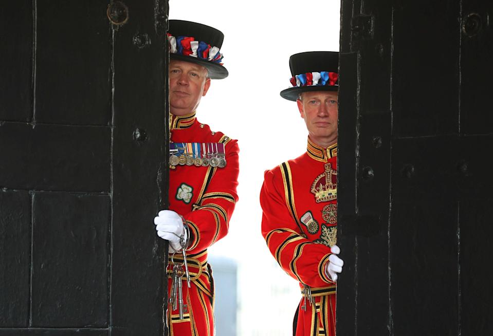 Yeoman Warder Darren Hardy (right) and Yeoman Serjeant Clive Towell (left) open the West Door at the Tower of LondonPA