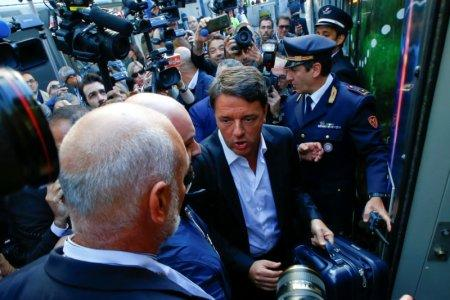 Italy's Former Prime Minister Matteo Renzi arrives to board a train during his electoral tour