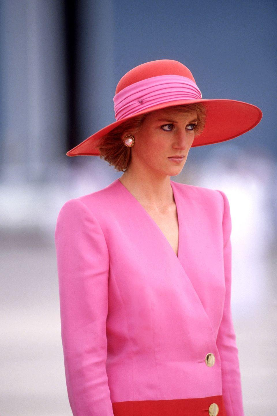 <p>In a pink-and-red dress by Catherine Walker on a Royal Tour in Dubai, United Arab Emirates. </p>