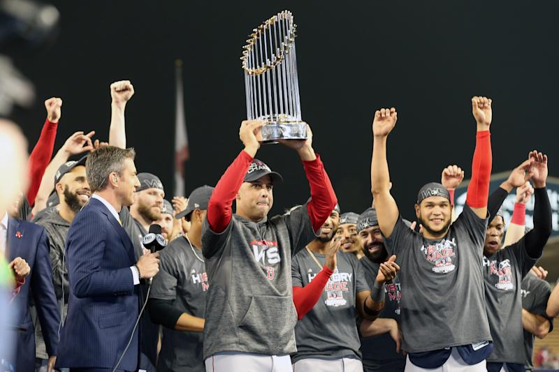 LOS ANGELES, CA - OCTOBER 28: Boston Red Sox manager Alex Cora #20 raises the World Series trophy after the Boston Red Sox defeat the Los Angeles Dodgers during Game 5 of the 2018 World Series at Dodger Stadium on Sunday, October 28, 2018 in Los Angeles, California. (Photo by Rob Leiter/MLB via Getty Images)