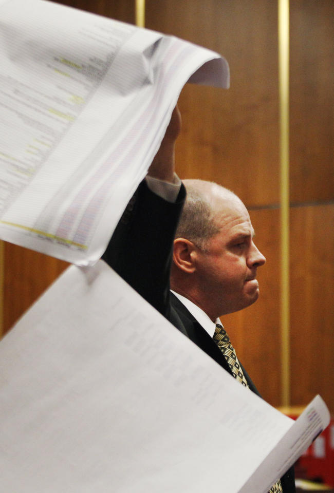 Prosecutor Kevin O'Connor holds up cell phone records during his closing arguments in the trial of Adam Longoria in Barton County District Court in Great Bend, Kan., Friday, April 6, 2012. Longoria is charged with capital murder in the August 2010 death of Alicia DeBolt. (AP Photo/Orlin Wagner, Pool)