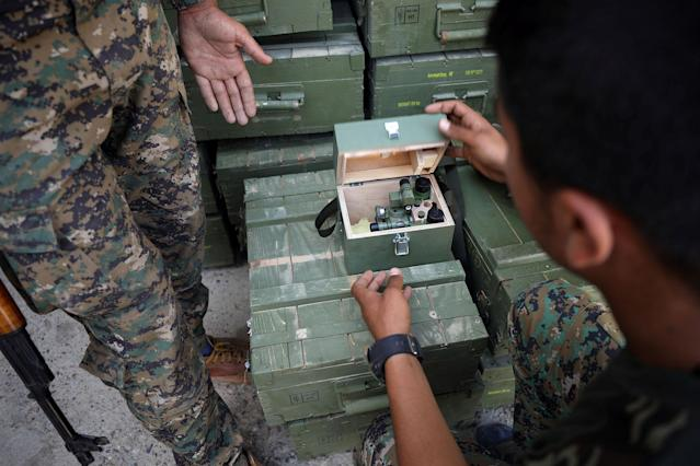 <p>Syrian Democratic Forces (SDF) fighters unload boxes of ammunition near Raqqa city, Syria June 7, 2017. (Photo: Rodi Said/Reuters) </p>