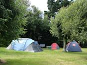 """<p><span>Within cycling distance of Brittany's best beaches, </span><a href=""""https://coolcamping.com/campsites/europe/france/north-west-france/brittany-normandy/2479-flower-camping-les-genets"""" rel=""""nofollow noopener"""" target=""""_blank"""" data-ylk=""""slk:Camping Les Genets"""" class=""""link rapid-noclick-resp""""><span>Camping Les Genets</span></a><span> offers traditional camping among the greenery with family-friendly facilities in spades. There's a swimming pool, water slides, sports pitches, a playground and static caravans, as well as a section dedicated to traditional tent campers. A tent and two people from €14.50 (£12.30). [Photo: Cool Camping]</span> </p>"""