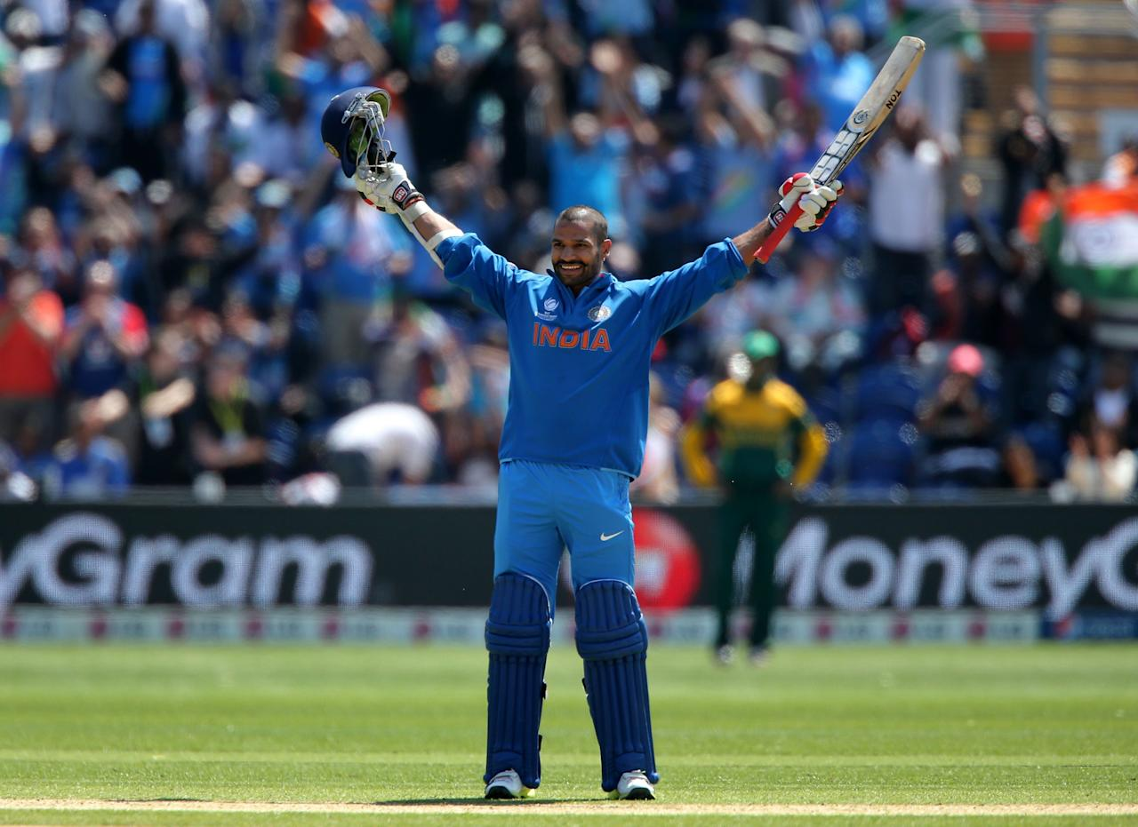 India's Shikhar Dhawan celebrates his 100 not out against South Africa on opening day of the ICC Champions Trophy. The SWALEC Stadium, Cardiff.