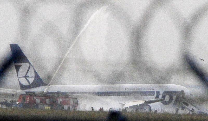 FILE - This Nov. 1, 2011 photo shows a Boeing 767 of Polish LOT airlines with 231 people on board that successfully belly landed at the Frederic Chopin airport in Warsaw, Poland. Polish aviation experts said Wednesday, Oct. 31, 2012 that a broken hydraulic hose and an off fuse prevented the systems from working, while the cockpit handbook did not provide guidance for the case of alternate system's failure. The plane's pilot, Tadeusz Wrona was named a hero for the safe landing, during which no one was hurt. (AP Photo/Czarek Sokolowski, File)