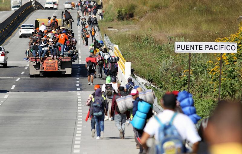 "Members of the migrant caravan say they are seeking a better future away from Central America's ""Northern Triangle"" (AFP Photo/ULISES RUIZ)"