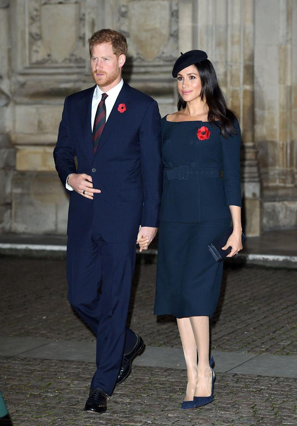 """<p>The Duke and Duchess joined other members of the royal family at Westminster Abbey for <a href=""""https://www.townandcountrymag.com/style/fashion-trends/a24851110/meghan-markle-navy-blue-wwi-remembrance-service-photos/"""" rel=""""nofollow noopener"""" target=""""_blank"""" data-ylk=""""slk:a final Armistice Day service."""" class=""""link rapid-noclick-resp"""">a final Armistice Day service.</a> The Duchess wore a navy skirt and shoulder-skimming peplum top for the event, again with a large poppy pin.</p>"""