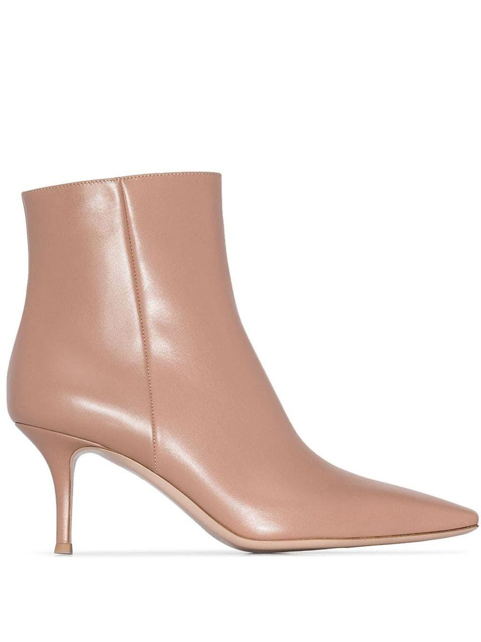 """<p><strong>Gianvito Rossi</strong></p><p>farfetch.com</p><p><strong>$455.00</strong></p><p><a href=""""https://go.redirectingat.com?id=74968X1596630&url=https%3A%2F%2Fwww.farfetch.com%2Fshopping%2Fwomen%2Fgianvito-rossi-stiletto-ankle-boots-item-13679633.aspx&sref=https%3A%2F%2Fwww.harpersbazaar.com%2Ffashion%2Ftrends%2Fg7958%2Fhow-to-wear-ankle-boots%2F"""" rel=""""nofollow noopener"""" target=""""_blank"""" data-ylk=""""slk:Shop Now"""" class=""""link rapid-noclick-resp"""">Shop Now</a></p><p>Gianvito Rossi's neutral ankle boot is both minimal and elegant—and sure to stand out among a sea of all-black booties. </p>"""