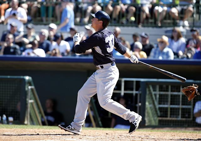 New York Yankees' Kelly Johnson watches his two-run homer in the third inning of a spring exhibition baseball game against the Houston Astros, Saturday, March 8, 2014, in Kissimmee, Fla. (AP Photo/Alex Brandon)