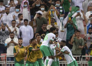 Saudi Arabia's players celebrate after they won the match against Japan 1-0 of the Asian zone group B qualifying soccer match for the FIFA World Cup Qatar 2022 at the King Abdullah sports city stadium, in Jiddah, Saudi Arabia, Thursday, Oct. 7, 2021. (AP Photo)