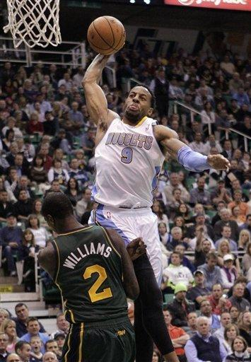 Denver Nuggets Andre Iguodala (9) drives to the basket as Utah Jazz forward Marvin Williams (2) defends in the second quarter during an NBA basketball game Monday, Nov. 26, 2012, in Salt Lake City. (AP Photo/Rick Bowmer)
