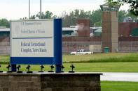 """FILE PHOTO: A vehicle patrols the perimeter of the Federal Correctional Complex where John Walker Lindh, known as the """"American Taliban"""" was released early this morning in Terre Haute"""