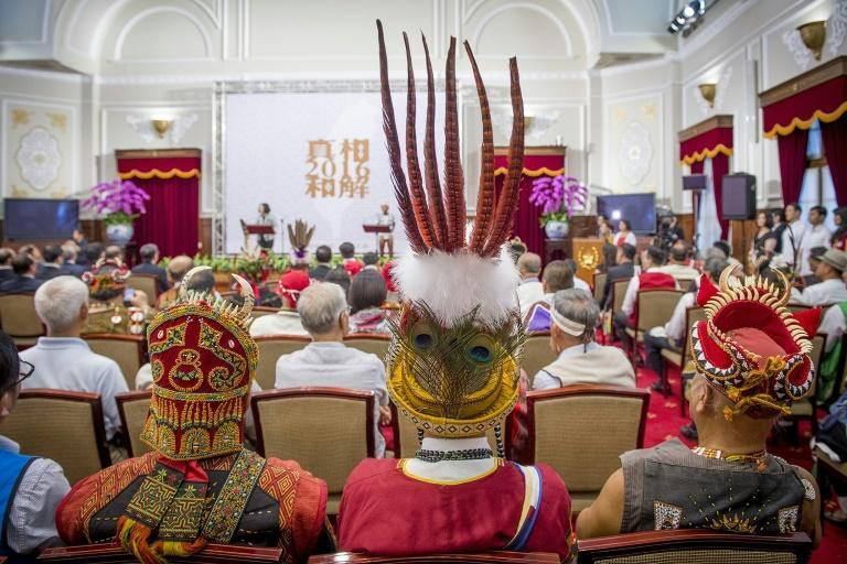 Representatives from some of Taiwan's 16 indigenous tribes attend a ceremony at the presidential office in Taipei on August 1, 2016