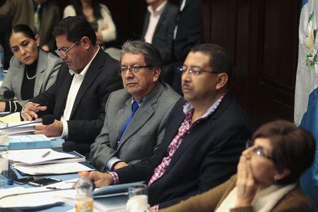 Members of an investigative commission in charge of deciding if Guatemalan President Otto Perez Molina is to be stripped of his diplomatic immunity, participate in a hearing, in Guatemala City