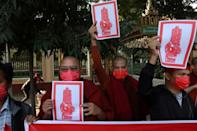 Protesters flashed the three-finger salute that has come to symbolise opposition to Myanmar's military coup