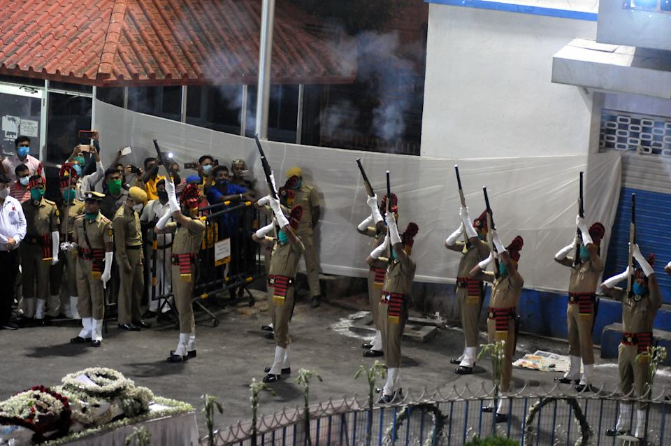 Police personnel pay Gun Salute during the funeral of iconic Bengali actor Soumitra Chatterjee, who died today after an over-a-month-long battle with multiple ailments, in Kolkata, Sunday, 15 November.