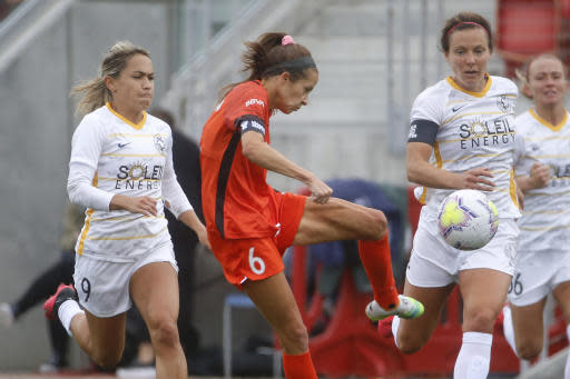 Houston Dash forward Shea Groom (6) takes a shot as Utah Royals FC midfielder Lo'eau LaBonta (9) defends during the first half of an NWSL Challenge Cup soccer match at Zions Bank Stadium Tuesday, June 30, 2020, in Herriman, Utah. (AP Photo/Rick Bowmer)