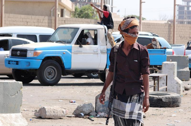 Yemeni pro-regime fighters patrol a street in the southern port city of Aden, on November 1, 2015