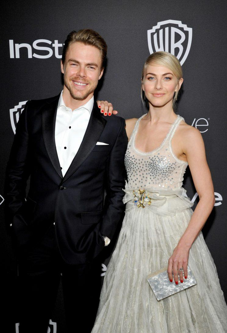 Siblings Derek and Julianne Hough partying after the Golden Globes on Sunday. (Photo: Getty Images)