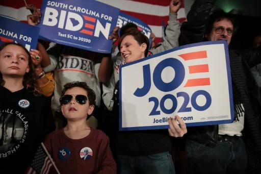Supporters of Democratic presidential candidate Joe Biden celebrate his South Carolina primary victory