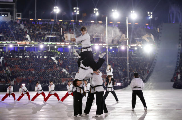 <p>Martial arts practitioners perform ahead of the opening ceremony of the 2018 Winter Olympics in Pyeongchang, South Korea, Friday, Feb. 9, 2018. (AP Photo/Jae C. Hong) </p>