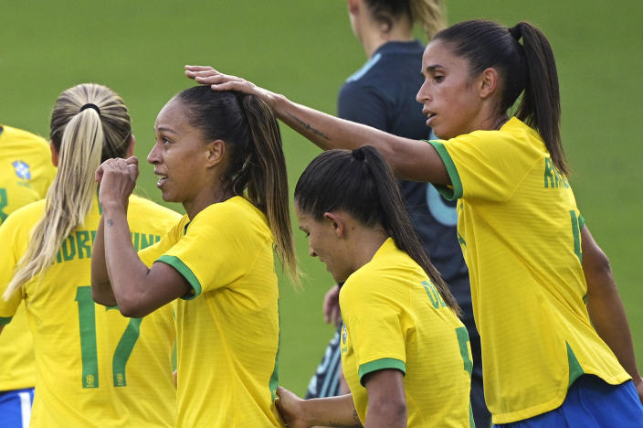 Brazil midfielder Adriana, left, is congratulated by Rafaelle, right, after Adriana scored a goal during the second half of a SheBelieves Cup women's soccer match, Thursday, Feb. 18, 2021, in Orlando, Fla. (AP Photo/Phelan M. Ebenhack)