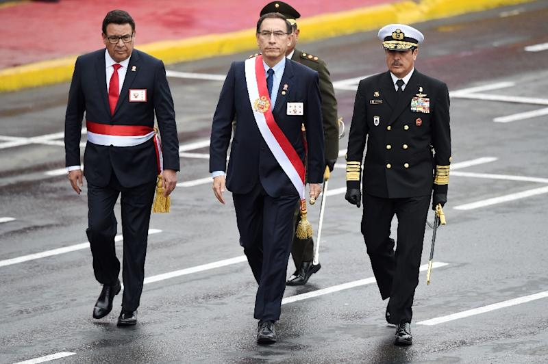 Peru's late defense minister Jose Huerta (L), seen walking next to President Martin Vizcarra (C) at a celebratory parade in Lima in July 2018, died of a heart attack suffered during a visit to troops