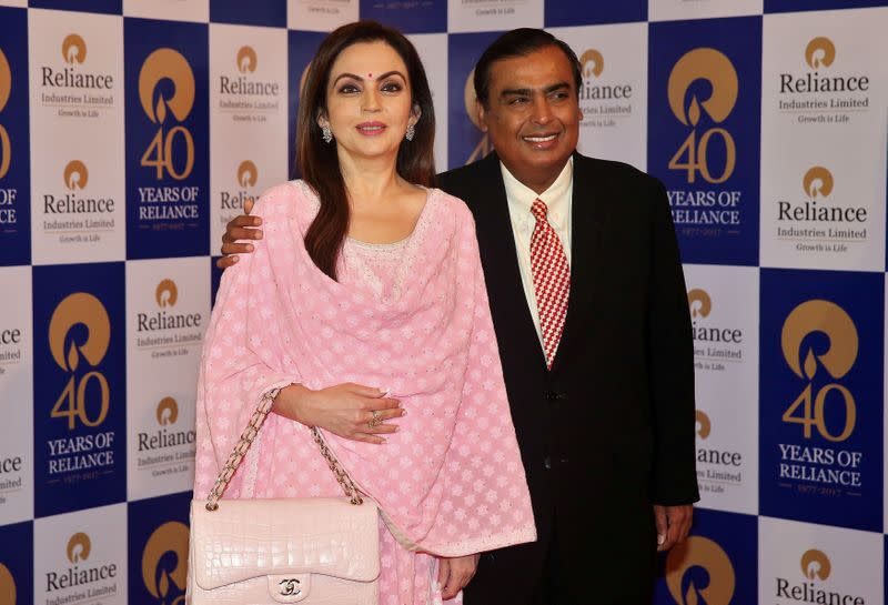 FILE PHOTO: Mukesh Ambani, Chairman and Managing Director of Reliance Industries, poses with wife Nita Ambani before addressing the company's annual general meeting in Mumbai