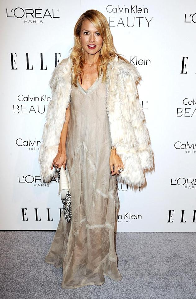 "Celeb stylist and reality star Rachel Zoe worked it in a free-flowing Calvin Klein dress and a faux fur from her own QVC line. Do you think she looks pregnant, as UsMagazine.com recently reported? Steve Granitz/<a href=""http://www.wireimage.com"" target=""new"">WireImage.com</a> - October 18, 2010"