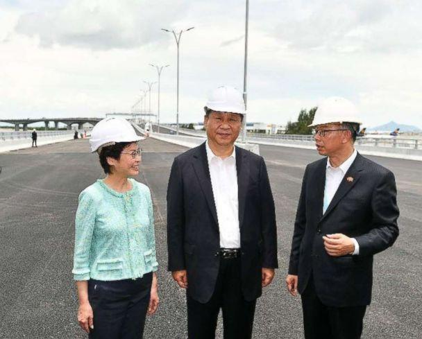 PHOTO: President Xi Jinping (C) is briefed by the Secretary for Transport and Housing, Mr Frank Chan Fan (R) on the Hong Kong section of the Hong Kong-Zhuhai-Macao Bridge (HZMB) during his inspection of the HZMB Hong Kong Link Road, July 1, 2018. (The Government of the Hong Kong Special Administrative Region)