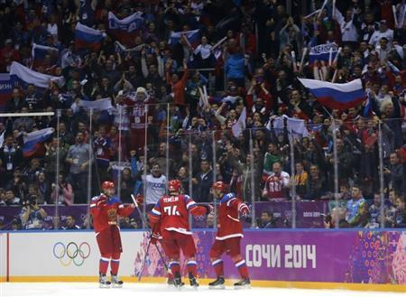 Russia's Ilya Kovalchuk (R) celebrates his goal against Norway with teammates Alexei Yemelin (C) and Alexander Radulov (L) during the second period of their men's qualification round ice hockey game at the 2014 Sochi Winter Olympic Games, February 18, 2014. REUTERS/Mark Blinch