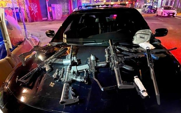 Police found a cache of weapons in a nearby building including crossbows, replica assault rifles, scopes, lights and lasers, after a man was shot with an arrow in Vancouver's Downtown Eastside. (Vancouver Police Department - image credit)