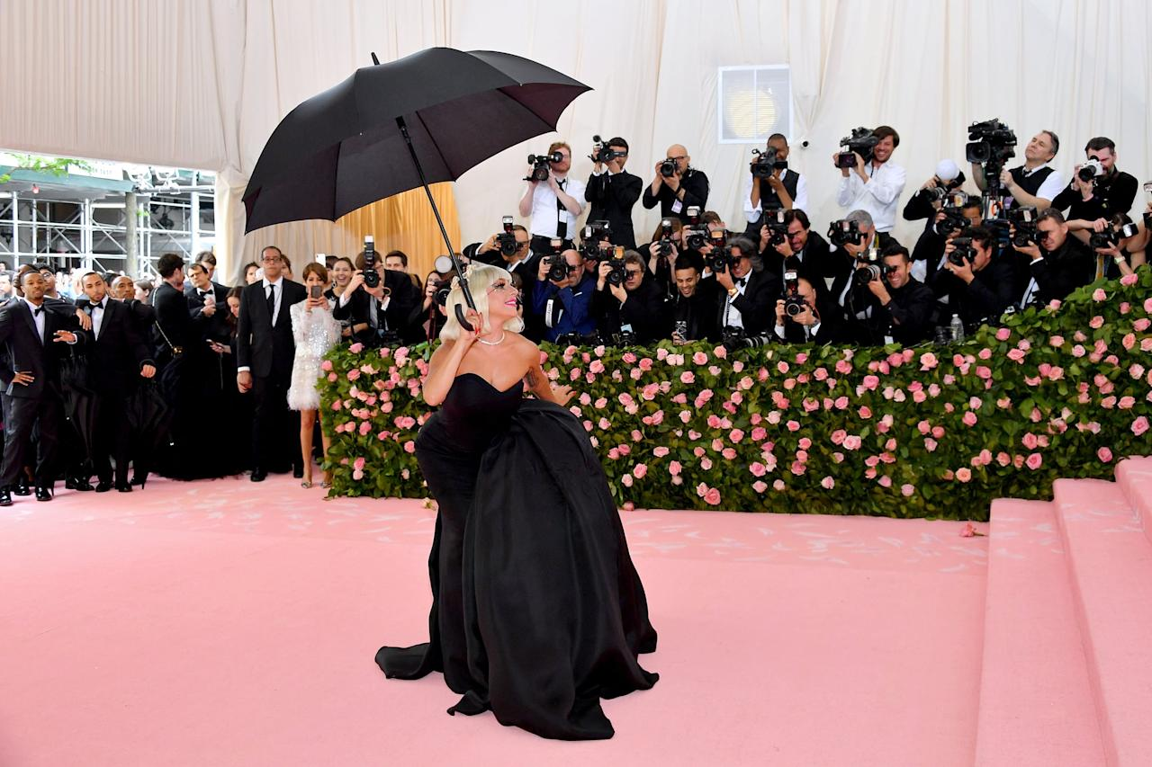 """<p><a class=""""sugar-inline-link"""" title=""""Latest photos and news for Lady Gaga"""" href=""""https://www.popsugar.com/Lady-Gaga"""" target=""""_blank"""">Lady Gaga</a>, styled by Brandon Maxwell, <a href=""""https://www.popsugar.com/fashion/Lady-Gaga-Dress-Met-Gala-2019-46115378"""" >made an epic entrance</a> at the Met Gala - making not one but four outfit changes on the red carpet. Her second look included a black umbrella, which as simple as it may look, still evoked an Old Hollywood feel.</p>"""