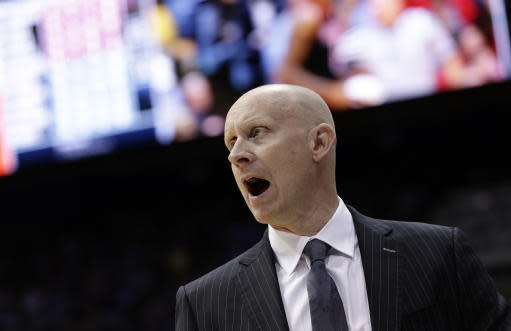 Louisville head coach Chris Mack directs his team during the first half of an NCAA college basketball game against North Carolina in Chapel Hill, N.C., Saturday, Jan. 12, 2019. (AP Photo/Gerry Broome)