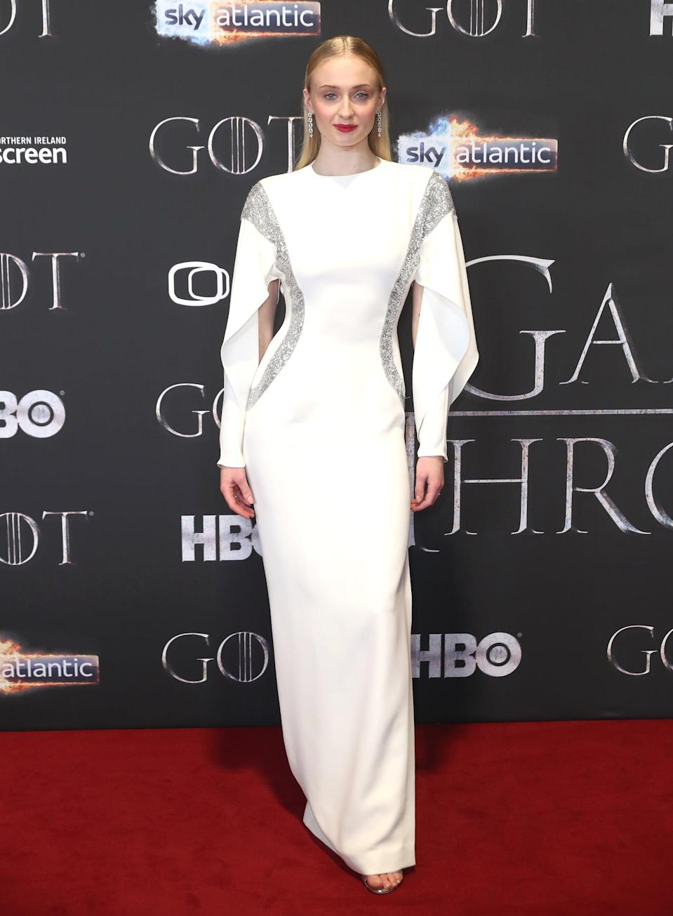 <p>At the <b>Game of Thrones</b> season eight Belfast premiere, Sophie wore a pre-fall 2019 Louis Vuitton gown with crisp lines, cutout bishop sleeves, and two sequined panels that ran from the top of her shoulders to the curve of her hips.</p>
