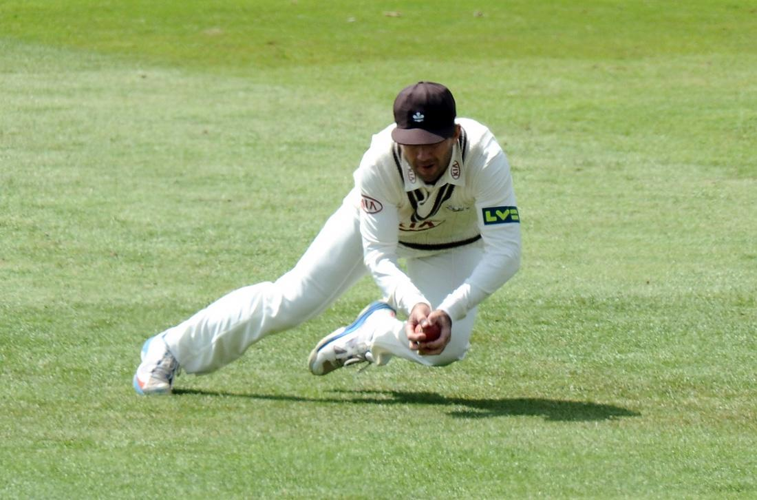 DERBY, ENGLAND - MAY 31:  Ricky Ponting of Surrey  dives to catch out Shivnarine Chanderpaul of Derbyshire during the LV County Championship - Division One match between Derbyshire and Surrey at The County Ground on May 31, 2013 in Derby, England.  (Photo by Tony Marshall/Getty Images)