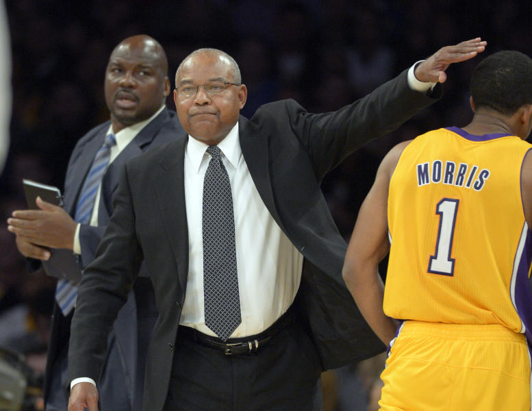 Los Angeles Lakers interim head coach Bernie Bickerstaff, center, pats guard Darius Morris on the head as assistant coach Chuck Person looks on during the first half of their NBA basketball game against the Golden State Warriors, Friday, Nov. 9, 2012, in Los Angeles. (AP Photo/Mark J. Terrill)