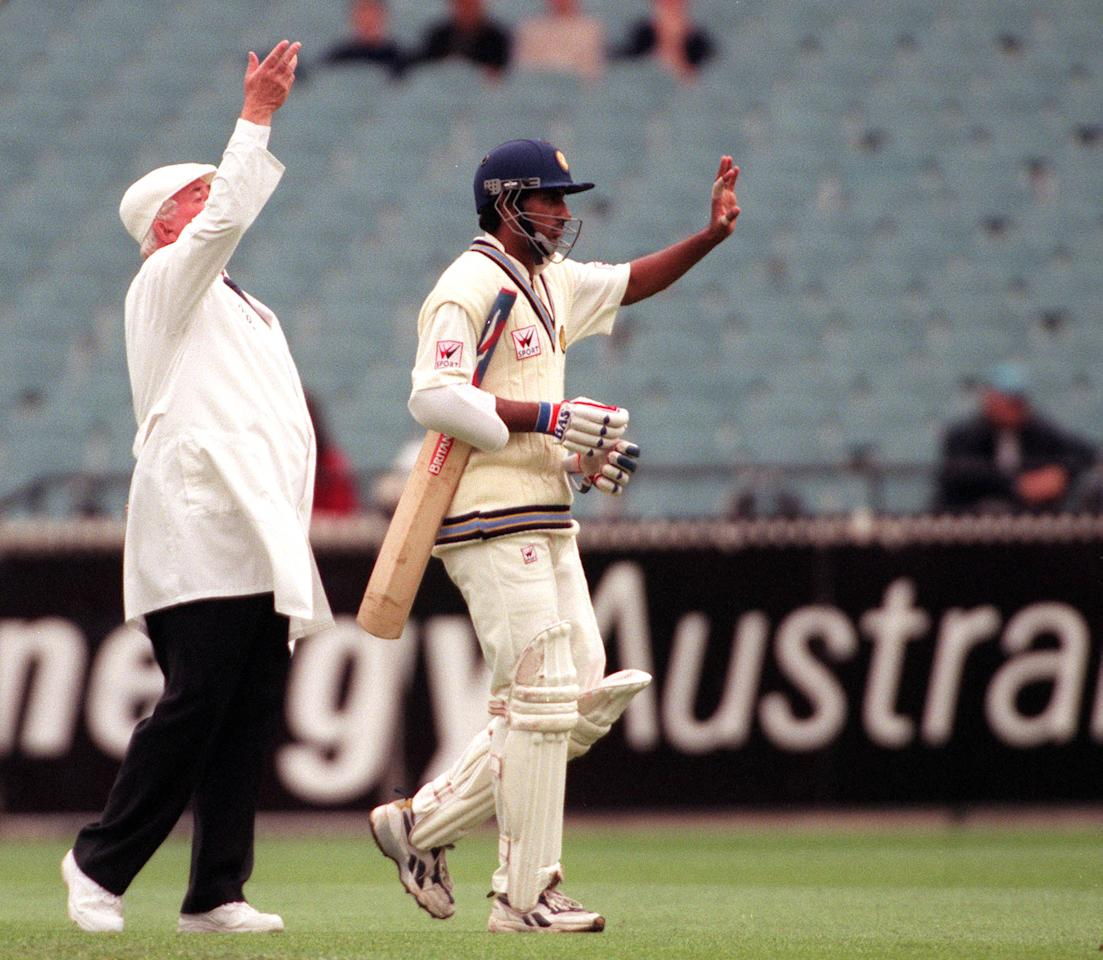 30  Dec 1999: Umpire David Shepherd and Sadagoppan Ramesh of India signal the retirement of Ramesh due to injury, on day five of the second test match between Australia and India at the Melbourne Cricket Ground, Melbourne, Australia. Ramesh retired for 26 runs, after a thumb injury sustained during the previous days play. Mandatory Credit: Jack Atley/ALLSPORT