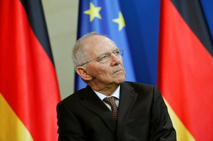 German Finance Minister Schaeuble attends a presentation of a newly designed 2-Euro coin at the Chancellery in Berlin